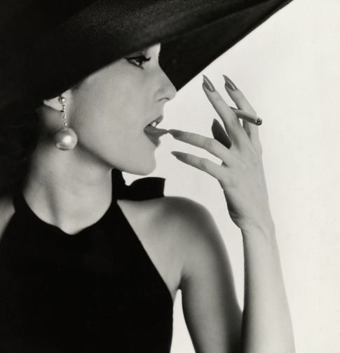 Irving Penn, Girl with Tobacco on Tongue (Mary Jane Russell), New York, 1951 © Condé Nast